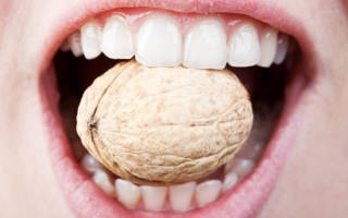 Зуб шатается и болит что делать